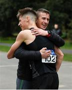 7 March 2020; David Kenny of Farranfore Maine Valley AC, Kerry, is congratulated by coach Rob Heffernan, right, following the Irish Life Health National 20k Walks Championships at St Anne's Park in Raheny, Dublin. Photo by Ramsey Cardy/Sportsfile