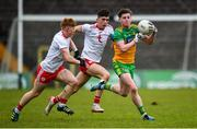 7 March 2020; Cormac Finn of Donegal in action against James McCann and Joe Ogus of Tyrone during the EirGrid Ulster GAA Football U20 Championship Final match between Tyrone and Donegal at St Tiernach's Park in Clones, Monaghan. Photo by Oliver McVeigh/Sportsfile