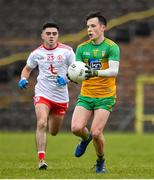7 March 2020; Aaron Doherty of Donegal in action against Tomas Donaghy of Tyrone during the EirGrid Ulster GAA Football U20 Championship Final match between Tyrone and Donegal at St Tiernach's Park in Clones, Monaghan. Photo by Oliver McVeigh/Sportsfile