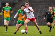 7 March 2020; Aaron Doherty of Donegal in action against Antoin Fox of Tyrone during the EirGrid Ulster GAA Football U20 Championship Final match between Tyrone and Donegal at St Tiernach's Park in Clones, Monaghan. Photo by Oliver McVeigh/Sportsfile