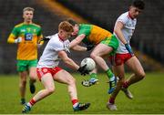 7 March 2020; Cormac Finn of Donegal in action against James McCann, left, and Joe Ogus of Tyrone during the EirGrid Ulster GAA Football U20 Championship Final match between Tyrone and Donegal at St Tiernach's Park in Clones, Monaghan. Photo by Oliver McVeigh/Sportsfile