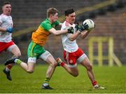 7 March 2020; Darragh Canavan of Tyrone in action against Oisin Walsh of Donegal during the EirGrid Ulster GAA Football U20 Championship Final match between Tyrone and Donegal at St Tiernach's Park in Clones, Monaghan. Photo by Oliver McVeigh/Sportsfile