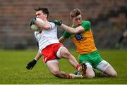 7 March 2020; Darragh Canavan of Tyrone is dragged down by Oisin Walsh of Donegal during the EirGrid Ulster GAA Football U20 Championship Final match between Tyrone and Donegal at St Tiernach's Park in Clones, Monaghan. Photo by Oliver McVeigh/Sportsfile