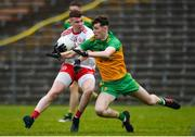 7 March 2020; Ethan Jordan of Tyrone in action against Rory O'Donnell of Donegal during the EirGrid Ulster GAA Football U20 Championship Final match between Tyrone and Donegal at St Tiernach's Park in Clones, Monaghan. Photo by Oliver McVeigh/Sportsfile
