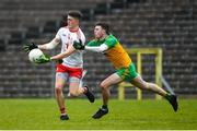 7 March 2020; Matthew Murnaghan of Tyrone in action against Luke Gavigan of Donegal during the EirGrid Ulster GAA Football U20 Championship Final match between Tyrone and Donegal at St Tiernach's Park in Clones, Monaghan. Photo by Oliver McVeigh/Sportsfile