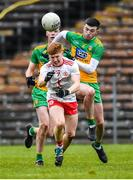 7 March 2020; James McCann of Tyrone is fouled by Luke Gavigan of Donegal, leading to a red card, during the EirGrid Ulster GAA Football U20 Championship Final match between Tyrone and Donegal at St Tiernach's Park in Clones, Monaghan. Photo by Oliver McVeigh/Sportsfile
