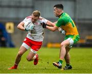 7 March 2020; Neil Kilpatrick of Tyrone in action against Eric Carr of Donegal during the EirGrid Ulster GAA Football U20 Championship Final match between Tyrone and Donegal at St Tiernach's Park in Clones, Monaghan. Photo by Oliver McVeigh/Sportsfile