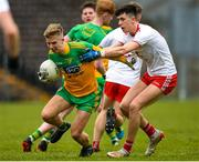 7 March 2020; Peter McEniff of Donegal in action against Joe Oguz of Tyrone during the EirGrid Ulster GAA Football U20 Championship Final match between Tyrone and Donegal at St Tiernach's Park in Clones, Monaghan. Photo by Oliver McVeigh/Sportsfile