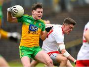 7 March 2020; Cormac Finn of Donegal in action against Matthew Murnaghan of Tyrone during the EirGrid Ulster GAA Football U20 Championship Final match between Tyrone and Donegal at St Tiernach's Park in Clones, Monaghan. Photo by Oliver McVeigh/Sportsfile