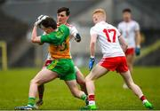 7 March 2020; Cormac Finn of Donegal in action against Darragh Canavan of Tyrone during the EirGrid Ulster GAA Football U20 Championship Final match between Tyrone and Donegal at St Tiernach's Park in Clones, Monaghan. Photo by Oliver McVeigh/Sportsfile