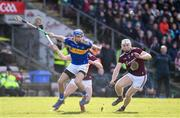 8 March 2020; John McGrath of Tipperary in action against Shane Cooney, right, and Darren Morrissey of Galway during the Allianz Hurling League Division 1 Group A Round 3 match between Galway and Tipperary at Pearse Stadium in Salthill, Galway. Photo by Sam Barnes/Sportsfile