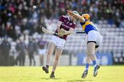 8 March 2020; Conor Cooney of Galway scores a point under pressure from Barry Heffernan of Tipperary during the Allianz Hurling League Division 1 Group A Round 3 match between Galway and Tipperary at Pearse Stadium in Salthill, Galway. Photo by Sam Barnes/Sportsfile