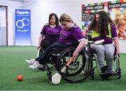 8 March 2020; As part of Seachtain na Gaeilge le Energia the GAA celebrated International Women's Day 2020 with Conradh na Gaeilge in Croke Park. Those present were treated to a skills exhibition from five intercounty wheelchair camogie players as part of the GAA's 'GAA For All' scheme in the players' warm up room. Following that, a discussion panel was held on the topic 'Women in Sport'. TG4 sports presenter and one of this year's Seachtain na Gaeilge personalities, Gráinne McElwain, facilitated the discussion and there was contributions from Eimear Considine, Imreoir Rugbaí le Foireann na hÉireann, Gearóidín Ní Thaibhís, An tOifigeach Náisiúnta Éagsúlachta agus Rannpháirtíochta CLG and Máire Treasa Ní Dhubhghaill, Spórt TG4. Giving an exhibition of wheelchair camogie at the event are, Caroline O'Halloran, from Ennis in Clare, Sarah Cregg, from Roscommon and Ellie Sheehy from Limerick. Photo by Brendan Moran/Sportsfile
