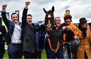 10 March 2020; Jockey Aidan Coleman, orange silks, with Put The Kettle On and winning Connections, including trainer Henry De Bromhead, second from left, after winning the Racing Post Arkle Challenge Trophy Novices' Chase on Day One of the Cheltenham Racing Festival at Prestbury Park in Cheltenham, England. Photo by David Fitzgerald/Sportsfile