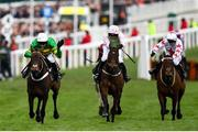 10 March 2020; Epatante, with Barry Geraghty up, left, on their way to winning the Unibet Champion Hurdle Challenge Trophy ahead of Sharjah, with Patrick Mullins up, centre, who finished second, on Day One of the Cheltenham Racing Festival at Prestbury Park in Cheltenham, England. Photo by Harry Murphy/Sportsfile