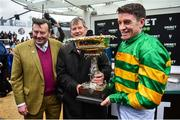 10 March 2020; Jockey Barry Geraghty, right, trainer Nicky Henderson, left, and owner JP McManus after winning the Unibet Champion Hurdle Challenge Trophy with Epatante on Day One of the Cheltenham Racing Festival at Prestbury Park in Cheltenham, England. Photo by David Fitzgerald/Sportsfile