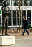 11 March 2020; Former jockey AP McCoy walks past a statue of himself on Day Two of the Cheltenham Racing Festival at Prestbury Park in Cheltenham, England. Photo by Harry Murphy/Sportsfile