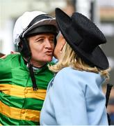 11 March 2020; Jockey Barry Geraghty kisses Noreen McManus after winning the RSA Insurance Novices' Chase on Day Two of the Cheltenham Racing Festival at Prestbury Park in Cheltenham, England. Photo by Harry Murphy/Sportsfile