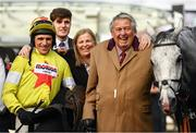11 March 2020; Jockey Harry Skelton, left, with, owner John Hales, right, and his wife Patricia, centre, after sending out Politologue to win the Betway Queen Mother Champion Chase on Day Two of the Cheltenham Racing Festival at Prestbury Park in Cheltenham, England. Photo by Harry Murphy/Sportsfile