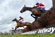 11 March 2020; Minella Indo, with Rachael Blackmore up, left, who came in second, jumping the last ahead of Allaho, with Paul Townend up, on their way to finishing the Ballymore Novices' Hurdle on Day Two of the Cheltenham Racing Festival at Prestbury Park in Cheltenham, England. Photo by Harry Murphy/Sportsfile