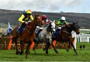 12 March 2020; The runner-up The Storyteller, with Davy Russell up, left, leads Tout Est Permis, with Eoin Walsh up, who finished third, centre, and the eventual winner Sire Du Berlais, with Barry Geraghty up, after jumping the last during the Pertemps Network Final Handicap Hurdle on Day Three of the Cheltenham Racing Festival at Prestbury Park in Cheltenham, England. Photo by David Fitzgerald/Sportsfile