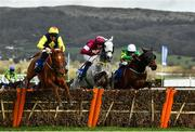 12 March 2020; The runner-up The Storyteller, with Davy Russell up, left, leads Tout Est Permis, with Eoin Walsh up, who finished third, centre, and the eventual winner Sire Du Berlais, with Barry Geraghty up, as they jump the last during the Pertemps Network Final Handicap Hurdle on Day Three of the Cheltenham Racing Festival at Prestbury Park in Cheltenham, England. Photo by David Fitzgerald/Sportsfile