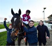 12 March 2020; Rob James on Milan Native, left, with trainer Gordon Elliott, right, celebrate after winning the Fulke Walwyn Kim Muir Challenge Cup Amateur Riders' Handicap Chase on Day Three of the Cheltenham Racing Festival at Prestbury Park in Cheltenham, England. Photo by David Fitzgerald/Sportsfile