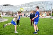 13 March 2020; Patrick Allan, aged 6, Johnny Murphy, aged 8, Toby Slye O'Connell, aged 11, and Rian O'Neill, aged 11, all from Sandymount in Dublin, play soccer on Havelock Square, beside the Aviva Stadium. Following directives from the Irish Government and the Department of Health the majority of the country's sporting associations have suspended all activity until March 29, in an effort to contain the spread of the Coronavirus (COVID-19). Photo by Sam Barnes/Sportsfile