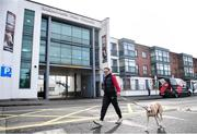 13 March 2020; Katie French from Ringsend in Dublin, walks her dog Harvey past Shelbourne Park Stadium. Following directives from the Irish Government and the Department of Health the majority of the country's sporting associations have suspended all activity until March 29, in an effort to contain the spread of the Coronavirus (COVID-19). Photo by Sam Barnes/Sportsfile