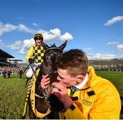13 March 2020; Stable Hand Paul Roche kisses Al Boum Photo after Paul Townend rode him to victory in the Magners Cheltenham Gold Cup Chase on Day Four of the Cheltenham Racing Festival at Prestbury Park in Cheltenham, England. Photo by David Fitzgerald/Sportsfile