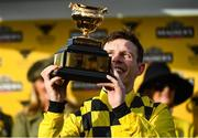 13 March 2020; Jockey Paul Townend with the cup after winning the Magners Cheltenham Gold Cup Chase on Al Boum Photo during Day Four of the Cheltenham Racing Festival at Prestbury Park in Cheltenham, England. Photo by Harry Murphy/Sportsfile