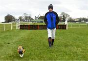 21 March 2020; Jockey Ricky Doyle goes for a walk with his dog, Millie, before his first race at Thurles Racecourse in Tipperary. Photo by Matt Browne/Sportsfile