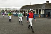 21 March 2020; Jockey Eoin Walsh, right, and fellow jockeys make their way to the parade ring, while maintaining social distancing, ahead of The Duggan Veterinary Handicap Steeplechase at Thurles Racecourse in Tipperary. Photo by Matt Browne/Sportsfile