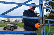 24 March 2020; Groundsman TJ Leahy locks the gates following racing at Clonmel Racecourse in Clonmel, Tipperary. Photo by Seb Daly/Sportsfile