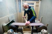 31 March 2020; David Dowling shapes the hurl by sanding off rough edges during a feature on The Star Hurley in Jenkinstown, Kilkenny. Photo by Ramsey Cardy/Sportsfile