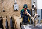 31 March 2020; Stephen Dowling shapes the hurl with a bandsaw during a feature on The Star Hurley in Jenkinstown, Kilkenny. Photo by Ramsey Cardy/Sportsfile