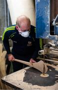 31 March 2020; David Dowling shapes the hurl with a bandsaw during a feature on The Star Hurley in Jenkinstown, Kilkenny. Photo by Ramsey Cardy/Sportsfile