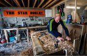 31 March 2020; David Dowling shapes the hurl with a spokeshave during a feature on The Star Hurley in Jenkinstown, Kilkenny. Photo by Ramsey Cardy/Sportsfile