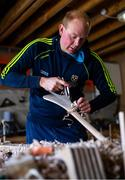 31 March 2020; David Dowling shapes the hurl with a hand plane during a feature on The Star Hurley in Jenkinstown, Kilkenny. Photo by Ramsey Cardy/Sportsfile
