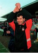 14 January 2000;  Longford Town manager, Stephen Kenny, celebrates at the end of the game after victory over Cork City. Cork City v Longford Town. FAI Harp Lager Cup  second round replay, Turners Cross, Cork. Soccer. Photo by David Maher/Sportsfile