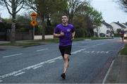 10 April 2020; Former Dundalk, Drogheda United, Bray Wanderers and current St Mochta's player Mick Daly, during his 8pm run, aims to raise much-needed funds for Cystic Fibrosis Ireland. So as to reflect 65 Roses, Mick Daly along with others are taking part in a challenge - 6k run every 5 hours over the day. The 6k route in Riverwood / Carpenterstown area was first run on Friday at 12am then 5am, 10am, 3pm and final one at 8pm. Photo by Stephen McCarthy/Sportsfile