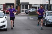 10 April 2020; Former Dundalk, Drogheda United, Bray Wanderers and current St Mochta's player Mick Daly, during his 8pm run, with the aid of former Dublin footballer Bernard Brogan, right,  aims to raise much-needed funds for Cystic Fibrosis Ireland. So as to reflect 65 Roses, Mick Daly along with others are taking part in a challenge - 6k run every 5 hours over the day. The 6k route in Riverwood / Carpenterstown area was first run on Friday at 12am then 5am, 10am, 3pm and final one at 8pm. Photo by Stephen McCarthy/Sportsfile