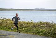 14 April 2020; Para-athlete Alex Lee during a training session near his home at Ballyloughane Strand in Renmore, Galway. Photo by Ramsey Cardy/Sportsfile
