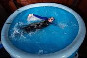29 April 2020; Swimmer Mia Whelan-O'Connor of ESB Swimming Club swims in her back garden in an inflatable pool using a swimming parachute and a bungee cord, in Inchicore, Dublin. Photo by Ramsey Cardy/Sportsfile