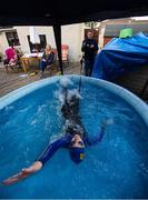 29 April 2020; Swimmer Mia Whelan-O'Connor of ESB Swimming Club swims in her back garden in an inflatable pool, in Inchicore, Dublin, using a swimming parachute and a bungee cord with the assistance of her Dad Michael and Mother Carol. Photo by Ramsey Cardy/Sportsfile