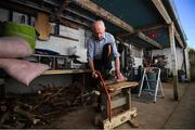 5 May 2020; Masters athlete Pat Naughton, age 87, cuts up wood following a training session at his home in Nenagh, Tipperary, during the on-going Coronavirus (COVID-19) pandemic. Photo by Stephen McCarthy/Sportsfile