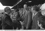 3 September 1989; The former Republic of Ireland manager Jack Charlton, 3rd from left, and his assistant Maurice Setters, right, are shown to their seats. All-Ireland Hurling Final, Tipperary v Antrim, Croke Park. Photo by Ray McManus/Sportsfile