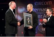 10 February 2002; Jack Charlton, receives his award for personality of the year from Paul McGrath, also pictured is President of the FAI, Milo Corcoran and eircom Chief Executive, Dr. Phil Nolan, (far right) eircom International Awards, Citywest Hotel, Saggart, Dublin. Soccer. Photo by David Maher/Sportsfile