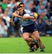 1 June 2002; Jonathan Magee, Dublin in action against Redmond Magee, Wexford, Dublin v Wexford, Bank of Ireland, Leinster Football Championship, Dr. Cullen Park, Carlow. Football. Photo by Damien Eagers/Sportsfile