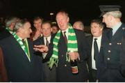 17 November 1993; Taoiseach Albert Reynolds T.D. welcomes Irish manager Jack Charlton at Dublin Airport on the teams return from the 1-1 draw with Northern Ireland at Windsor Park, Belfast. Photo by Ray McManus/Sportsfile